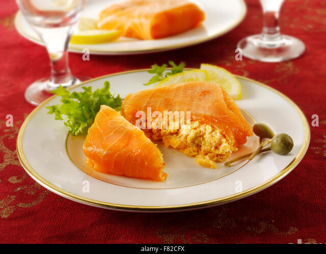 Close up of smoked salmon parcels recipe filled with salmon mousse ready to eat - Stock Image