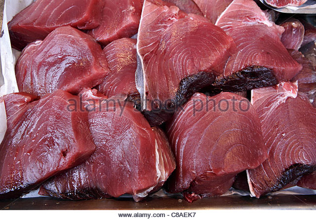 Thick pieces of red tuna on the fish stall - Stock Image