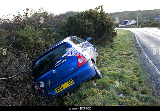 a car crashed, skidded on ice on a country lane, uk - Stock Image
