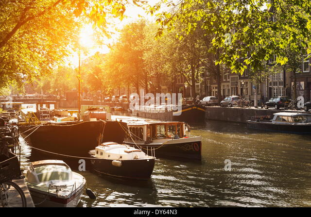 Sunlit canal, Amsterdam, The Netherlands, Europe - Stock Image