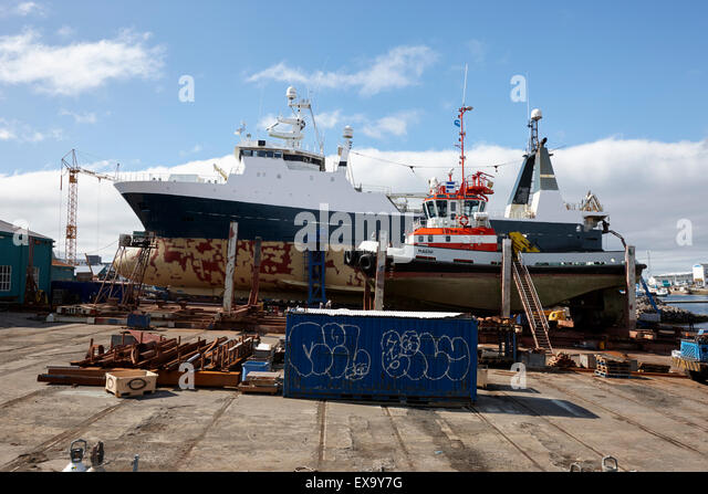 boats and ship in dry dock in reykjavik harbour iceland - Stock Image
