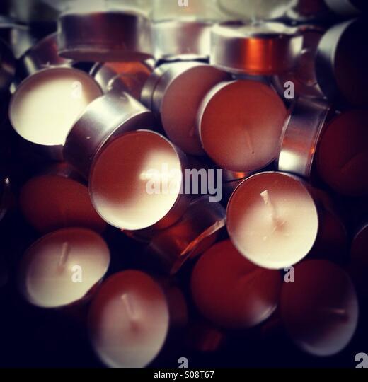 Tea lights, candles, wax, heat, light, dynamic light, many, lots of, wick. - Stock Image