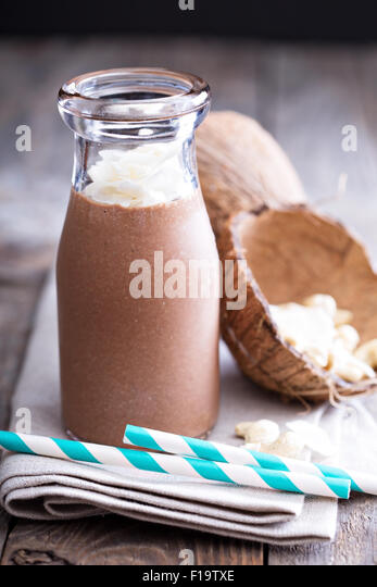 Healthy vegan chocolate coconut cashew shake in a bottle - Stock Image