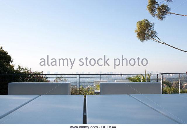 Balcony overlooking cityscape - Stock Image