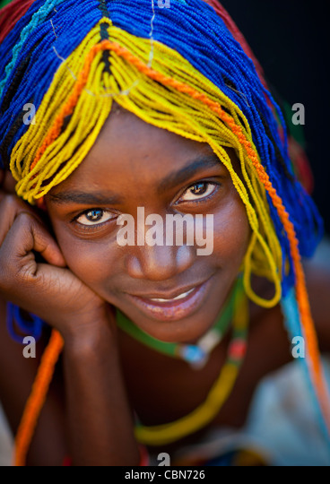 Mudimba Girl With A Beaded Wig Called Misses Ena, Village Of Combelo, Angola - Stock-Bilder