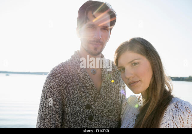 Portrait young couple romantic sunset lake - Stock-Bilder