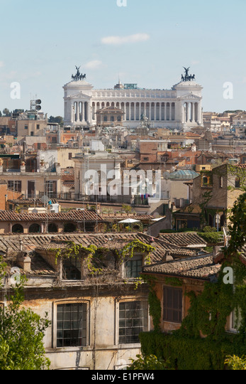 View across the Rome rooftops to the Vittorio Emanuele II building, Rome city center, Italy Europe - Stock Image