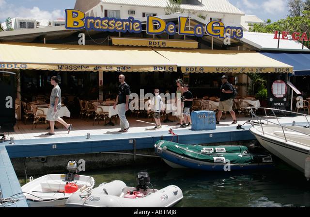 Saint Martin Marigot French Port la Royale family Brasserie De La Gare restaurant dock - Stock Image
