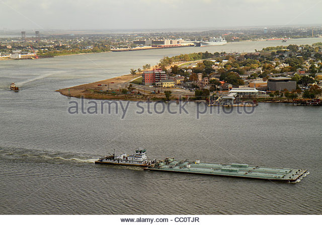 Louisiana New Orleans aerial Mississippi River Algiers waterway river bend transportation navigation barge towboat - Stock Image