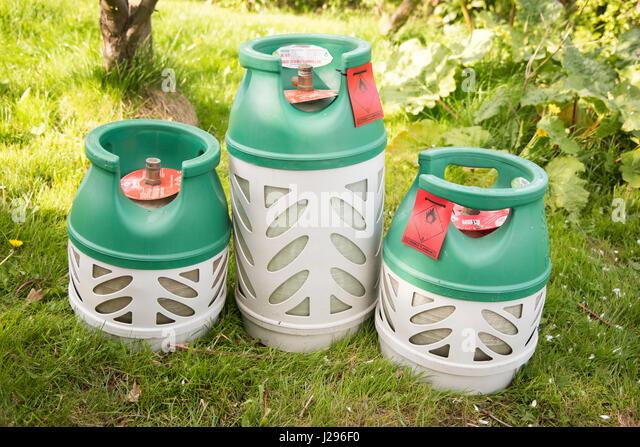 THree bottles of BP gaslite a lightweight butane gas cylinder for caravanning camping abd BBq's - Stock Image