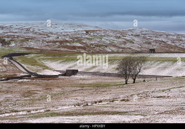 Largs Reservior Overflow with Victorian Pump Station  and Run Off with snow on the hills. Taken on a cold day. Two - Stock Image
