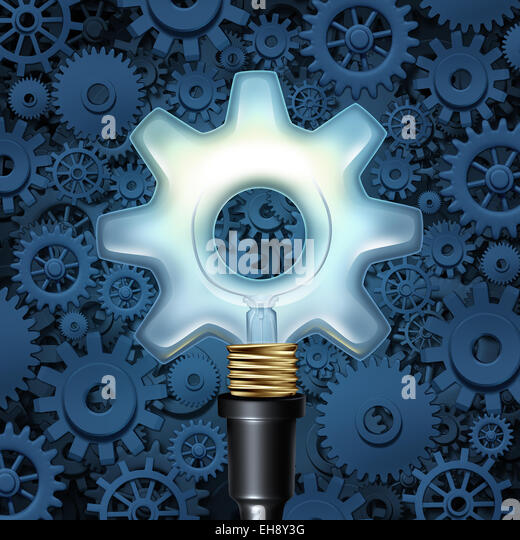 Light bulb with gears business concept as a light shaped as a cog wheel with machine parts in the background as - Stock Image
