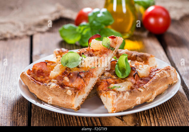 Fresh made Ham and Pineapple Pizza slices (close-up shot) - Stock Image