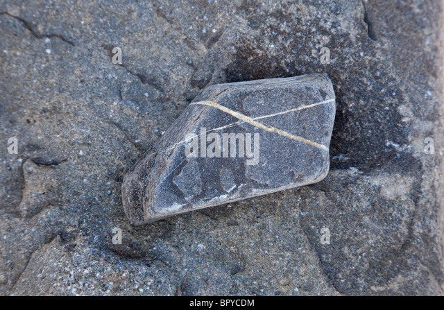 grey rock with x shape - Stock Image