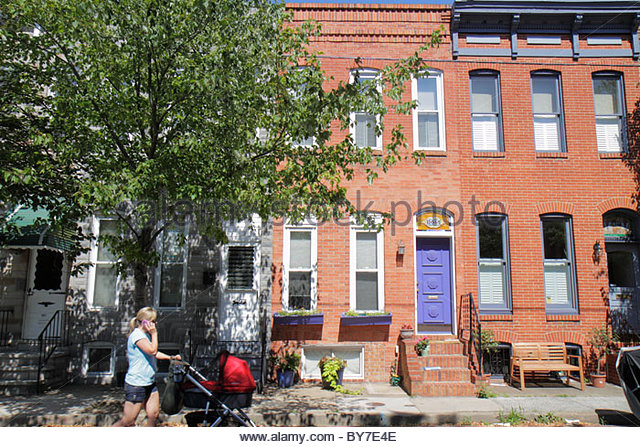 Baltimore Maryland Federal Hill historic neighborhood townhouse row house townhome townhouse red brick sidewalk - Stock Image