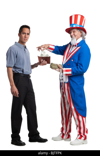 Man in Uncle Sam's costume taking money from other man, studio shot - Stock Image
