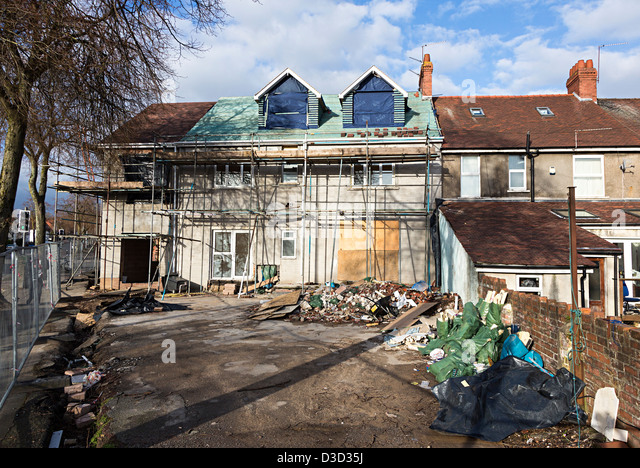 House in suburban setting with scaffolding due to a major extension being built, Cardiff, Wales, UK - Stock Image