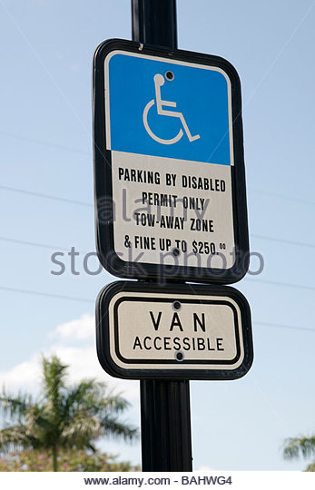 Florida Miramar sign blue disabled parking warning fine van accessible $250 tow-away wheelchair ADA accessibility - Stock Image