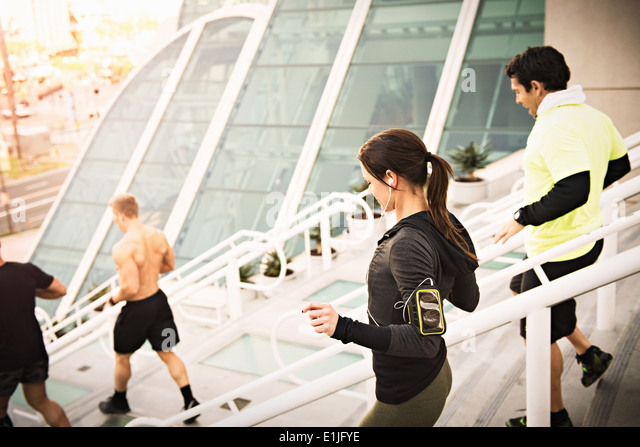 Small group of runners training on convention center steps - Stock Image