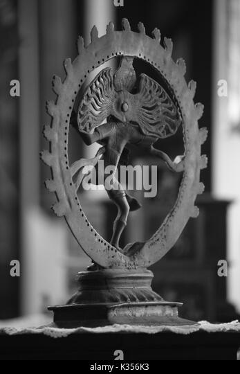 A view of an antique Natraj god sculpture from the rear view. - Stock Image