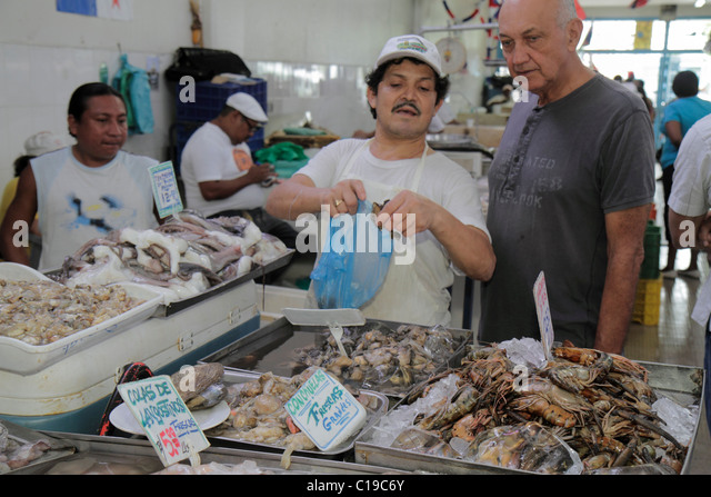 Panama City Panama Ancon Mercado de Mariscos market merchant selling shopping retail shrimp oyster seafood business - Stock Image