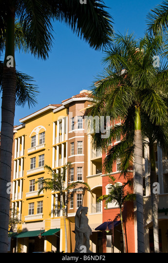 Bayfront Naples Florida fl shops shopping bright colors red yellow European architecture Naples Bay landmark - Stock Image