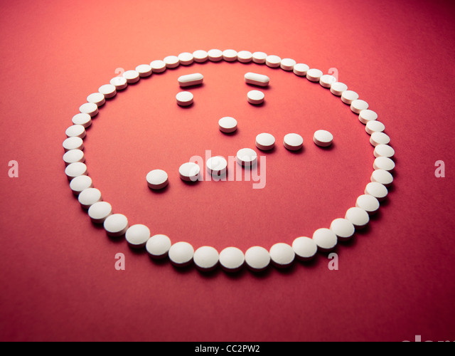 puzzled  face made out of pills and drugs - Stock Image