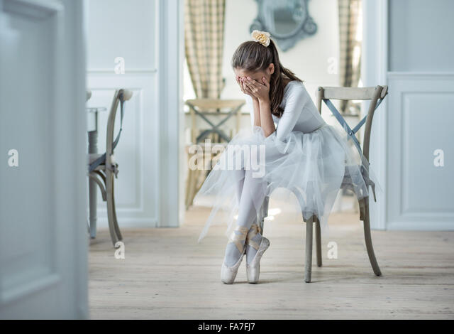 Sad ballet dancer crying in the cloak room - Stock Image