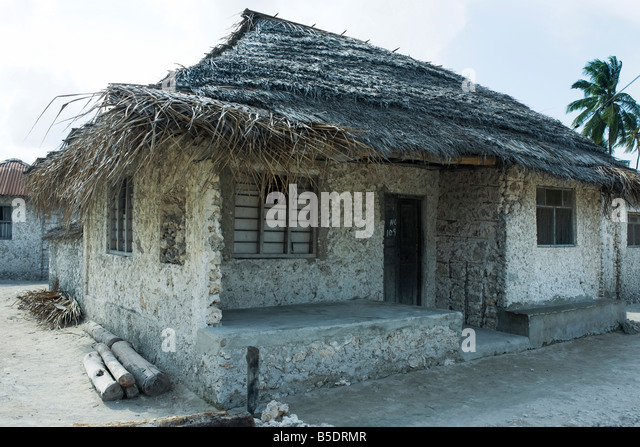 Tanzania, Zanzibar, house made of stone with thatched roof - Stock Image