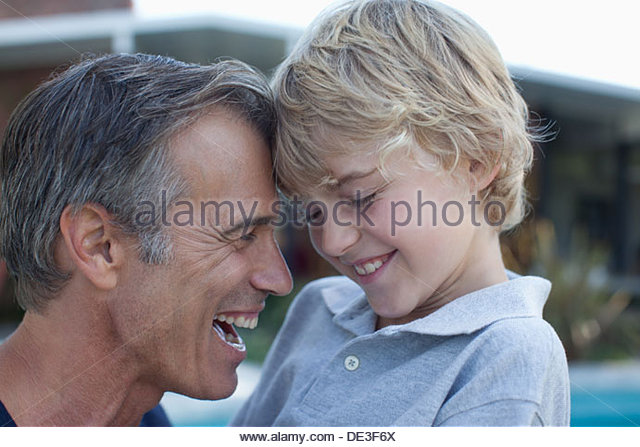 Father and son laughing together - Stock Image