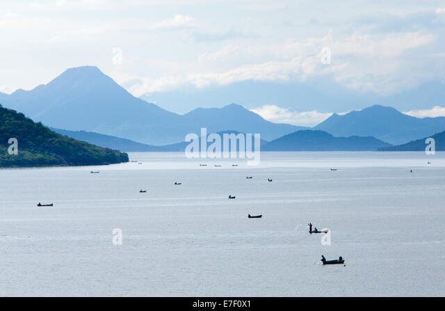 Fishermen at Infiernillo Reservoir located on the highway between Morelia and Ixtapa in Michoacan, Mexico - Stock Image