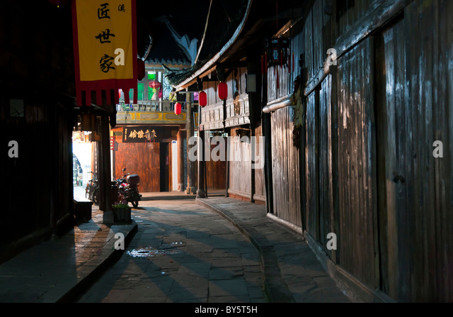 Cobbled street in the ancient town of Huanglongxi in the Sichuan Province of China at night. JMH4372 - Stock Image