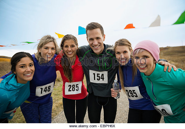 Portrait of confident marathon runners - Stock Image