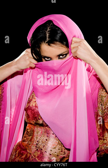 Arabian woman wearing traditional dress on black background - Stock Image