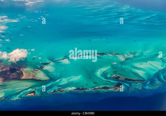 Aerial view of islands and clouds in the Bahamas. - Stock Image
