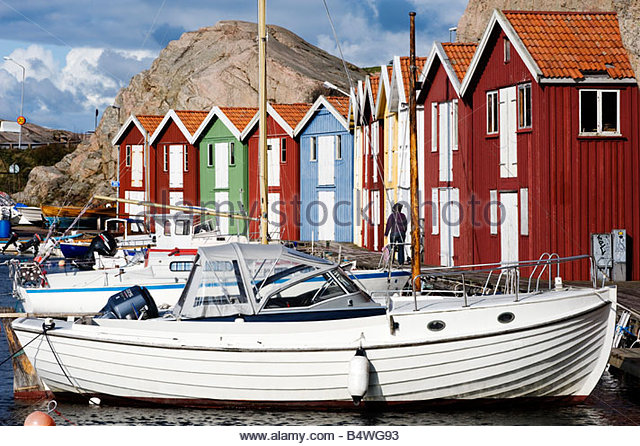 Boats and colourful boathouses at fishing village of Smogen on Bohuslan Coast in West Sweden 2008 - Stock Image