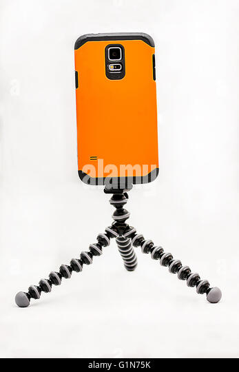 Mobile phone on a gorilla pod stand - Stock Image