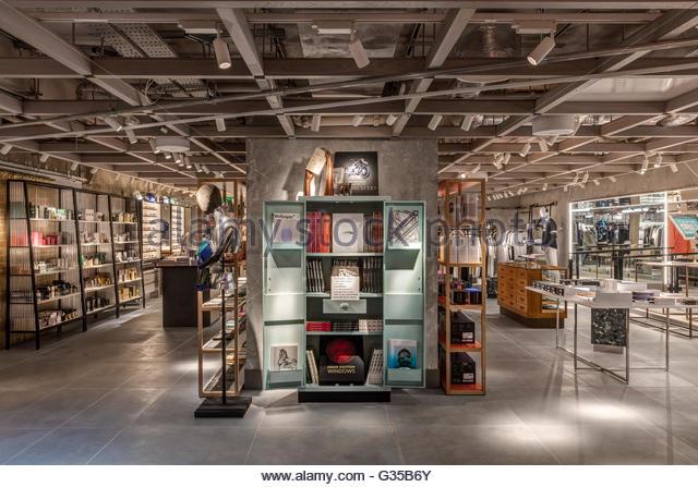 Stationary and books area. Harvey Nichols Menswear, London, United Kingdom. Architect: Virgile+Partners , 2016. - Stock Image