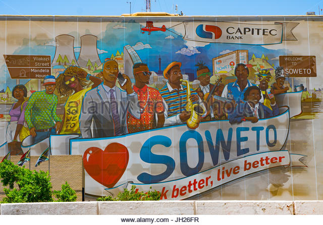 Public painted welcome and advertising sign of bank better, live better, on wall at entrance to Soweto, Johannesburg - Stock Image