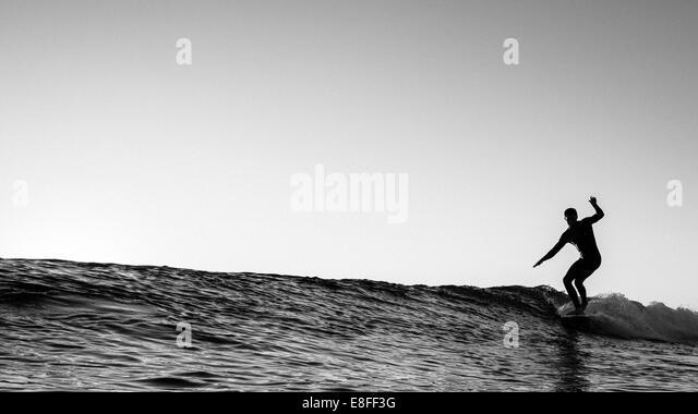 Surfer on wave - Stock-Bilder