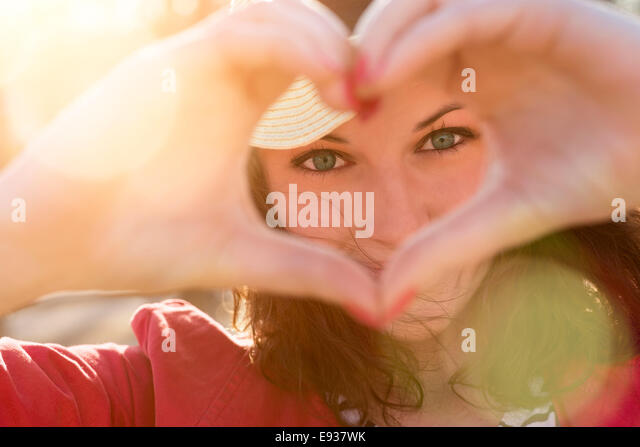 woman making a heart - Stock-Bilder