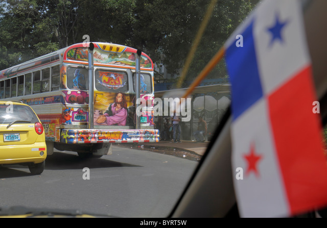 Panama City Panama Bella Vista street scene traffic car lane Diablo Rojo bus public transportation custom paint - Stock Image