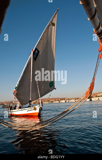Felucca traditional wooden sailboat portrait on Nile River Aswan Egypt profile lateen sails still life portrait - Stock Image
