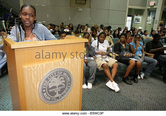 Miami Coconut Grove Florida City Hall Commission Chambers Mock City Commission Meeting students assume roles officials - Stock Image