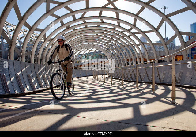 Melbourne webb bridge over yarra river, docklands harbour in Victoria Australia cyclist cycling path ride. with - Stock Image
