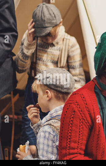 Two 40s boys and their mother having picnic near the tent - Stock Image