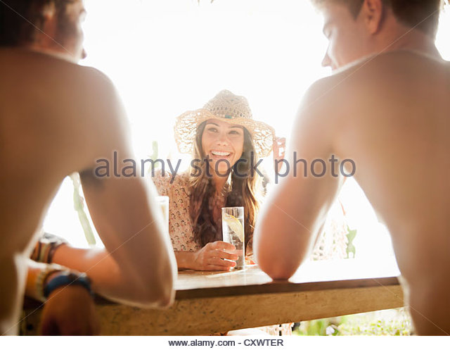 Friends having drinks outdoors - Stock Image