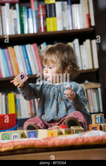 Girl playing with toys - Stock Image