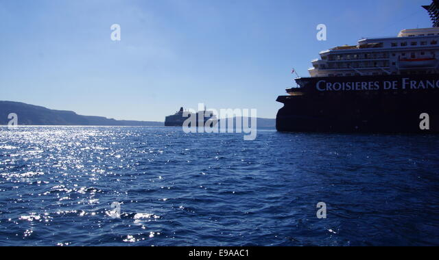 Cruise liners arriving in Santorini harbour, Greece. - Stock Image