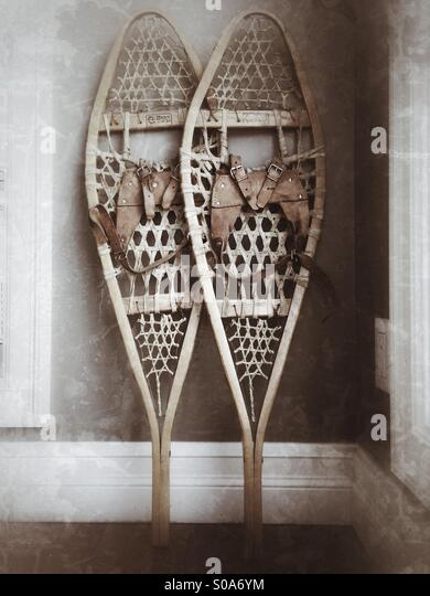 Vintage wooden snowshoes with leather bindings. - Stock Image